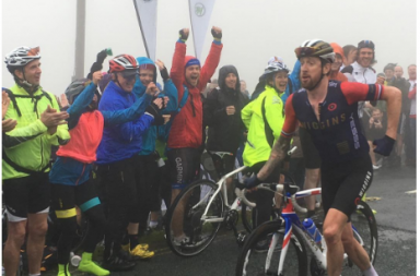 Cheeky Sir Bradley Wiggins running up a hill in Tour of Britain, paying a homage to Chris Froome's Tour de France antics. (Instagram)