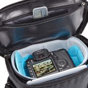 Storage compartment for cleaning supplies keeps dust out and safely stores memory cards in elastic slip pockets
