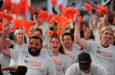 Participants cheer at Cycle for Survival's Times Square Takeover, Friday, Sept. 30, 2016, in New York. The ride kicked off registration for Cycle for Survival's 2017 events, which happen across the country in February and March. (Photo by Diane Bondareff/AP Images for Cycle for Survival)