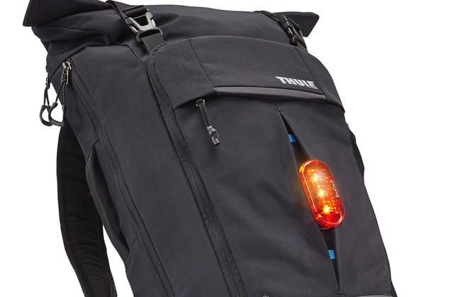 Integrated daisy chain attachment system for carabiner or bike light.