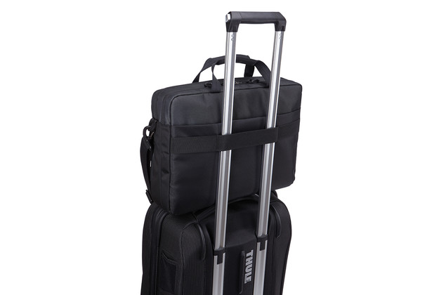 Luggage pass-through panel securely attaches bag to rolling luggage for effortless travel.
