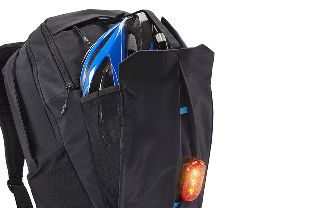 Hideway storage compartment easily untucks from front panel to quickly stash accessories or securely clip additional gear in place.